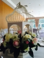 Bird cage centrepiece with fresh flowers